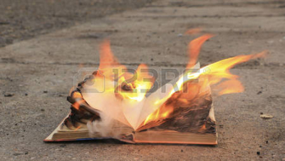 94447632-book-with-burning-pages-on-a-surface