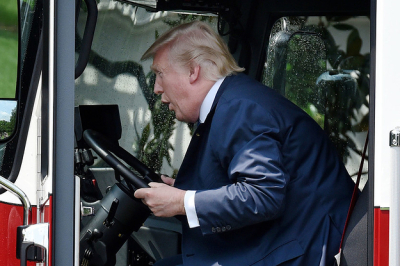 Trump-got-to-sit-in-a-big-red-fire-truck-because--2-12270-1500331176-5_dblbig